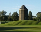 The dovecote overlooks the course
